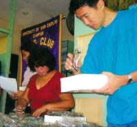 Sorting donated eyeglasses in the Phillipines.