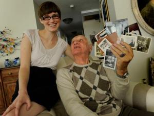 Jenna Kelly with Marshall Gold and his family's photos.